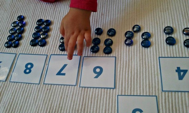 Numbers and counters with glass drops and number cards
