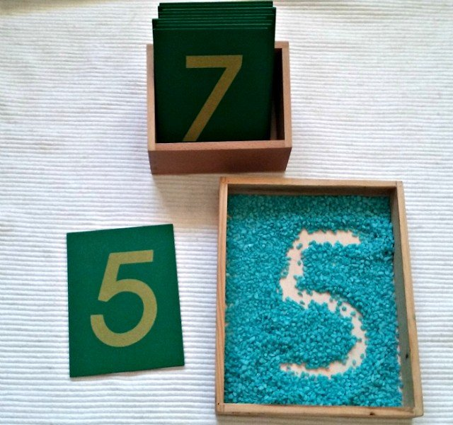 Sandpaper numbers and tracing tray with small rocks
