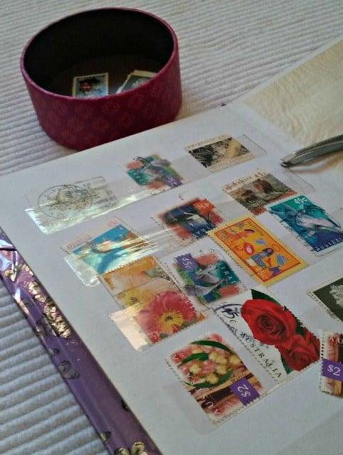 Stamps and tweezers activity.