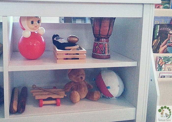Baby toy shelf with toys and musical instruments