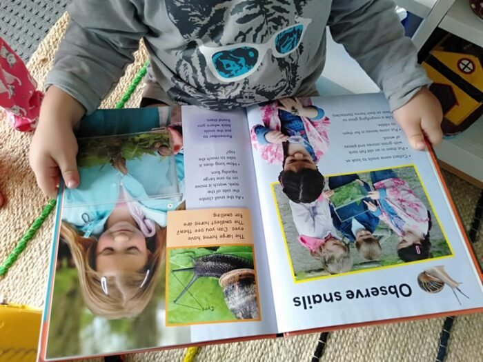 a child reading a book about outdoor play