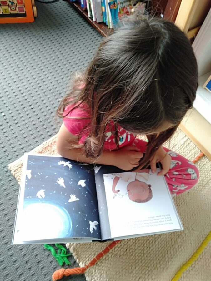 A child reading a biography book