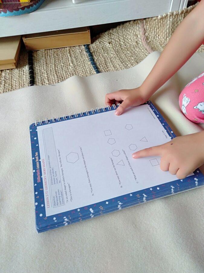 A child reading maths book