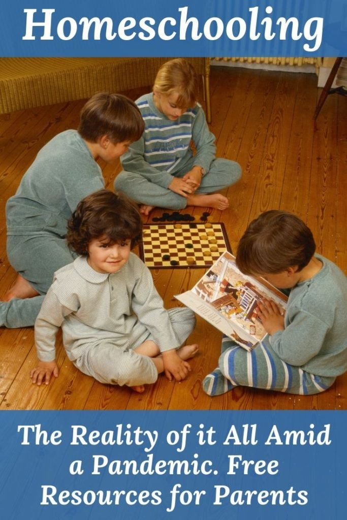 children playing on the floor board games