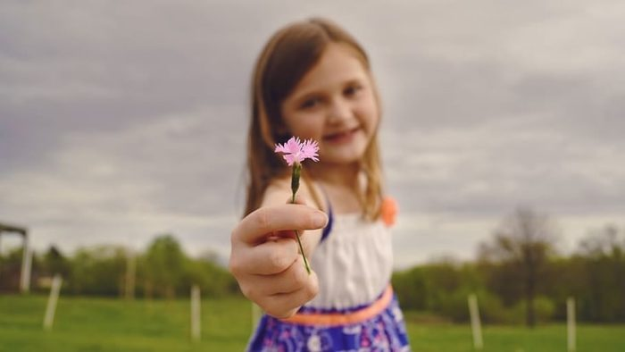 A girl holding a flower