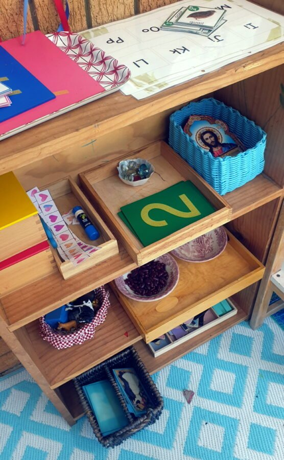 Shelf with activities for three year old children