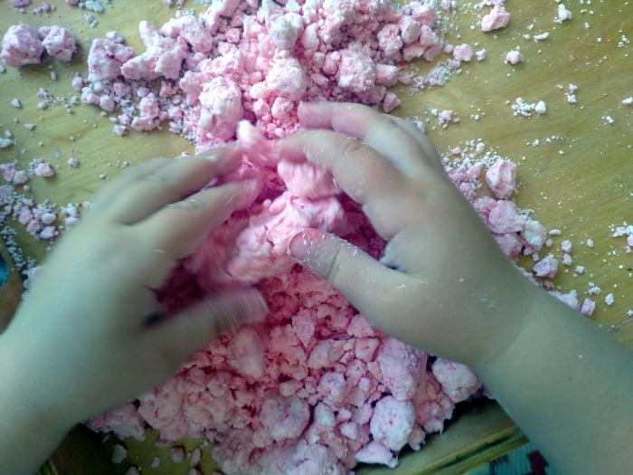A child playing with handmade playdough
