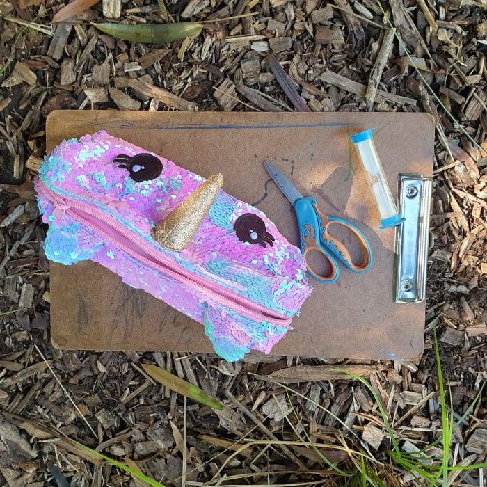 Pencil case, scissors, sand timer, clipboard
