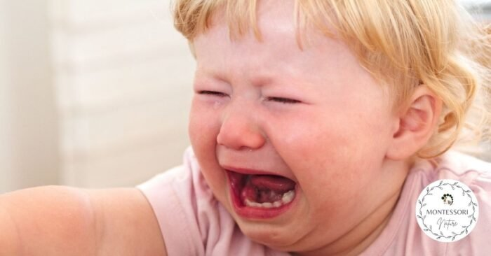 Toddler crying with mouth open