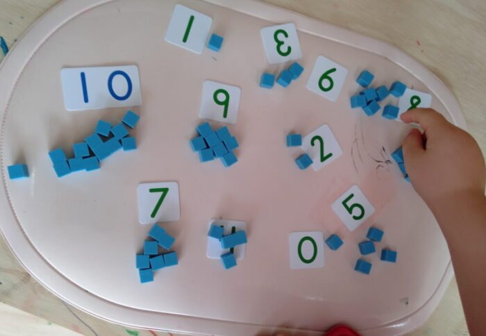 Math activity with number cards and unit cubes