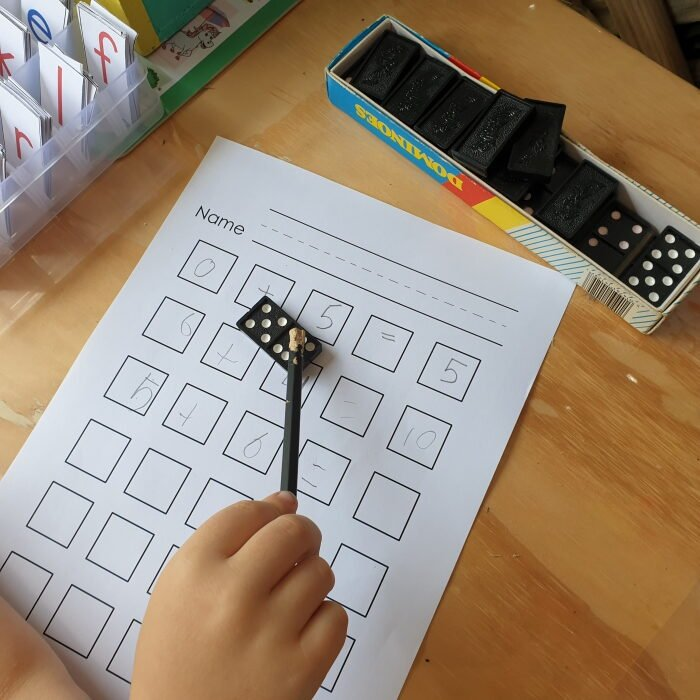Addition activity with dominoes