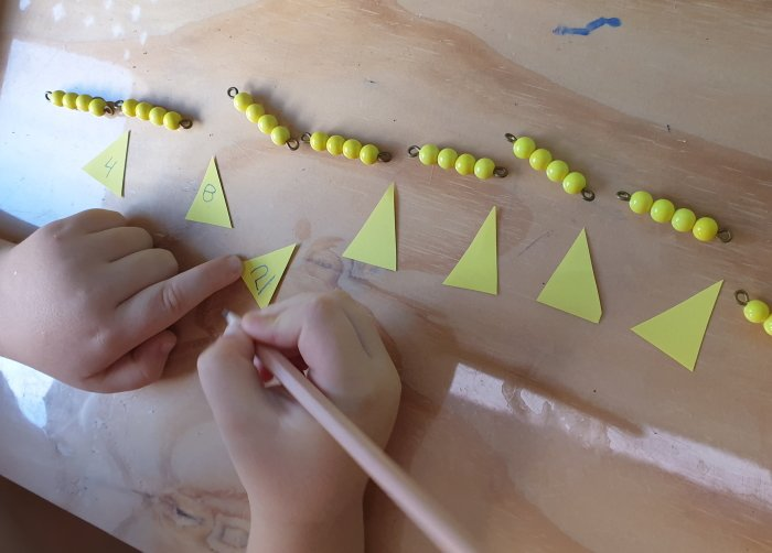 Counting by 4's with yellow math beads