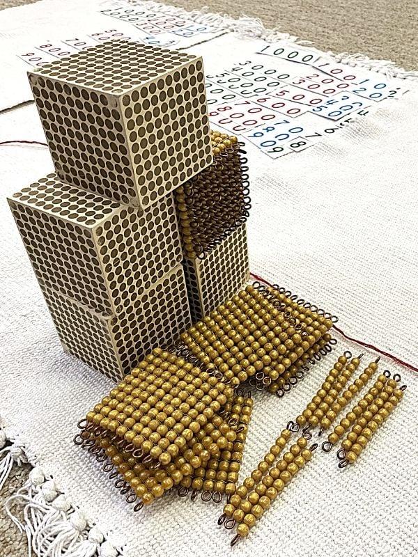 Golden beads - thousands, hundreds and tens